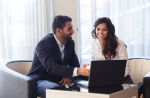 Young business couple with a laptop