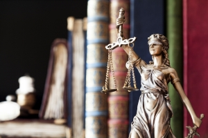 Statue of Lady Justice with legal books
