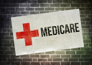Medicare sign painted on brick wall