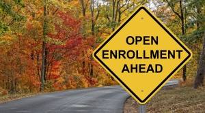Road sign saying open enrollment ahead