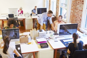 Busy office with employees working at desks