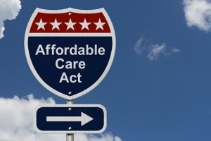 Street sign saying Affordable Care Act