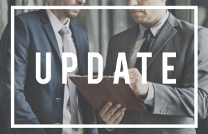 business men with clipboard and update in text overlay